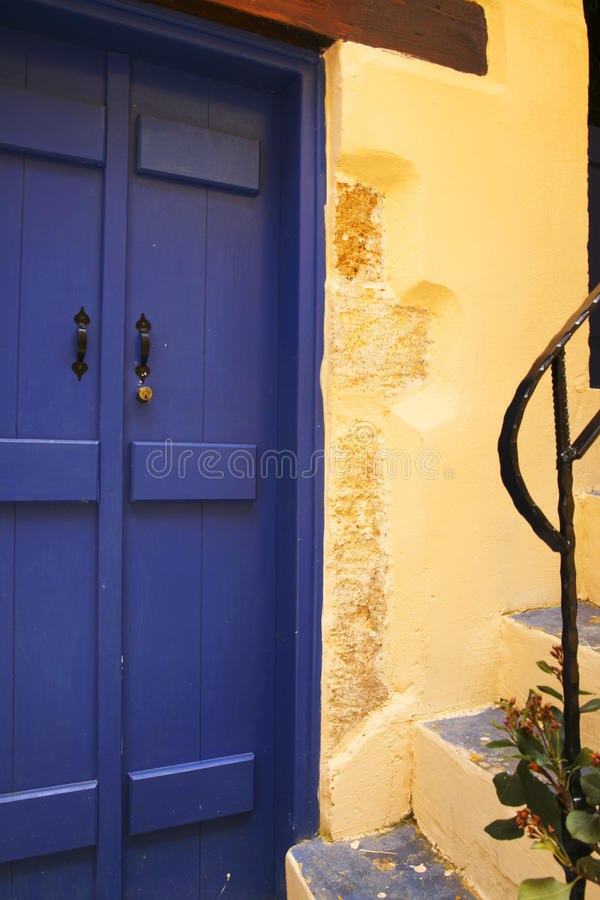 Mediterranean Blue Door With Yellow Wall Stock Photo - Image of ...