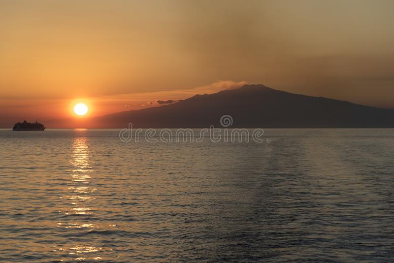 Mount Etna Sunset Sicily. Mount Etna is an active stratovolcano on the east coast of Sicily, Italy, in the Metropolitan City of Catania, between the cities of stock image