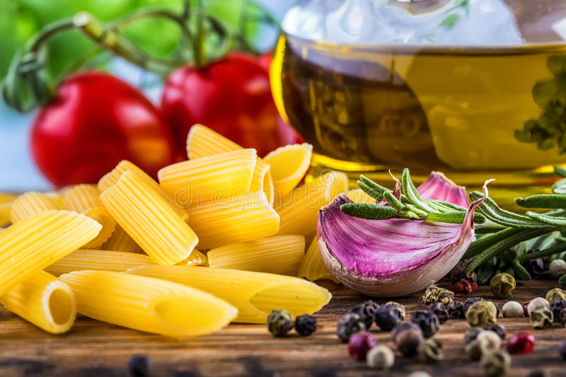 Mediterranean cuisine Pasta tagliatelle penne pepper thyme garlic cherry tomatoes and olive oil. royalty free stock photo