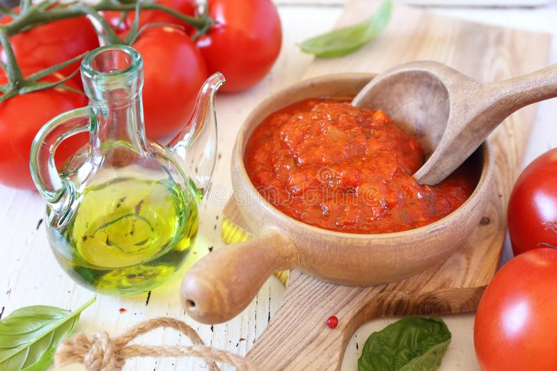 Mediterranean cuisine. Provencal sauce of ripe tomatoes, olive oil and basil. And it`s ingredients stock photo