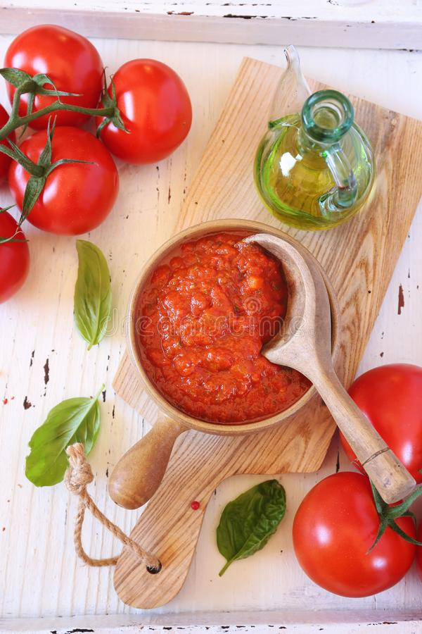 Mediterranean cuisine. Provencal sauce of ripe tomatoes, olive oil and basil. Top view stock photos