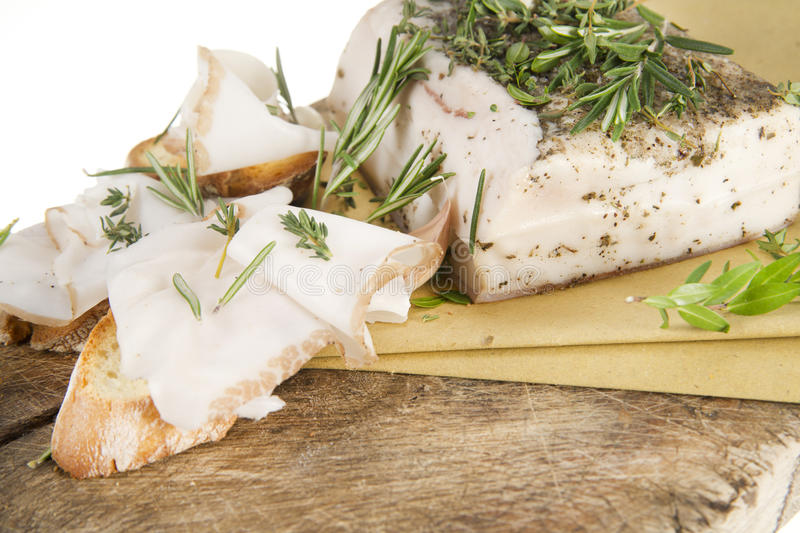 Mediterranean diet, bacon with herbs. royalty free stock photo