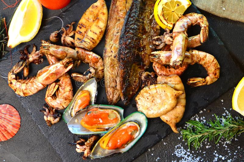 Mediterranean dinner with a grilled seafood. royalty free stock photography
