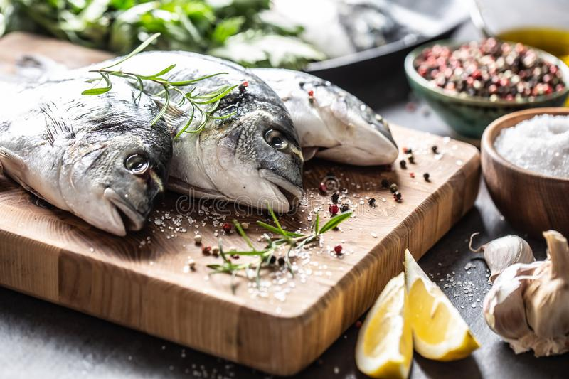 Mediterranean fish bream with spices salt herbs garlic and lemon. Healthy seafood. Concept of healthy sea food.  royalty free stock image