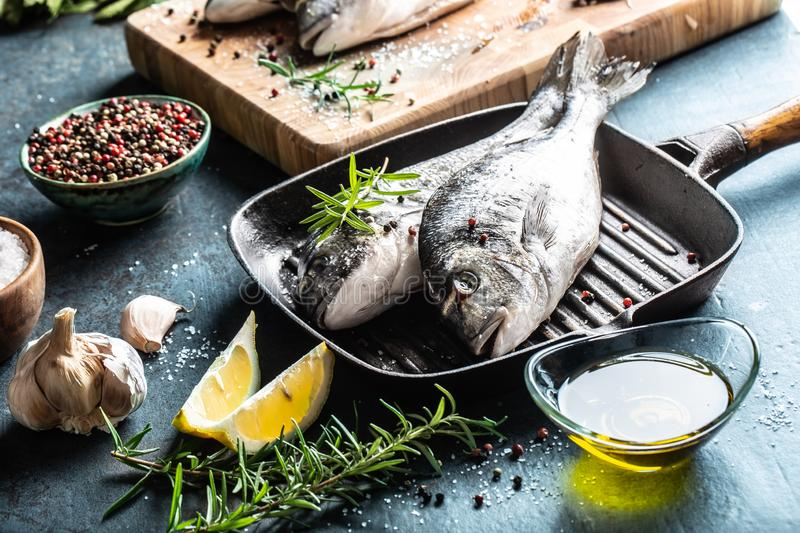 Mediterranean fish bream with spices salt herbs garlic and lemon. Healthy seafood. Concept of healthy sea food.  royalty free stock photo
