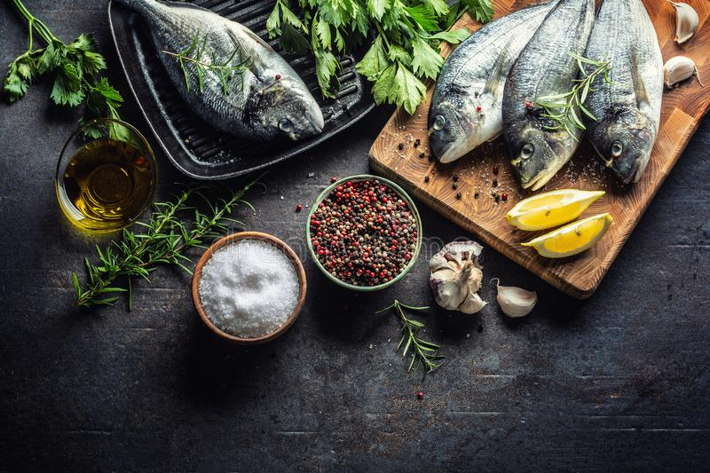 Mediterranean fish bream with spices salt herbs garlic and lemon. Healthy seafood. Concept of healthy sea food.  royalty free stock photos