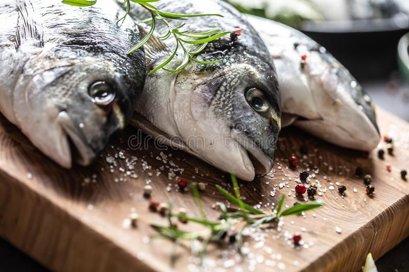 Mediterranean fish bream with spices salt herbs garlic and lemon. Healthy seafood. Concept of healthy sea food.  stock image
