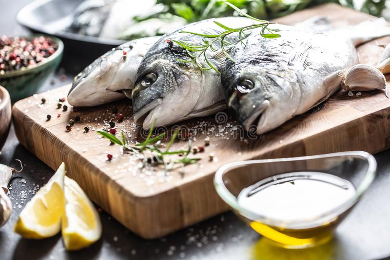 Mediterranean fish bream with spices salt herbs garlic and lemon. Healthy seafood. Concept of healthy sea food.  royalty free stock photography