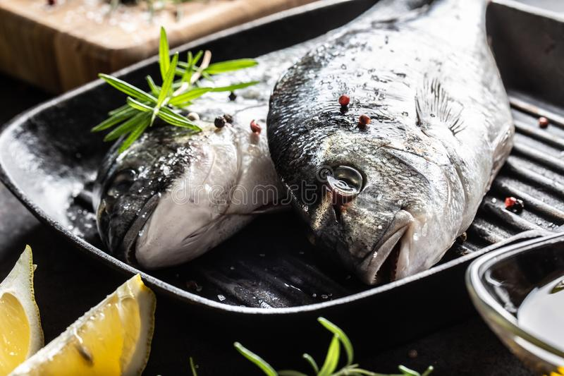 Mediterranean fish bream with spices salt herbs garlic and lemon. Healthy seafood. Concept of healthy sea food.  stock photos