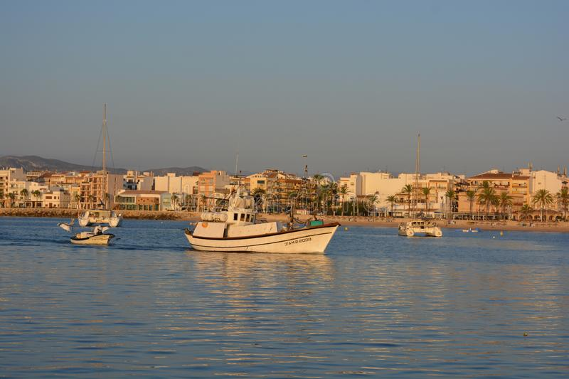 Mediterranean fishing trawler coming in to port stock images