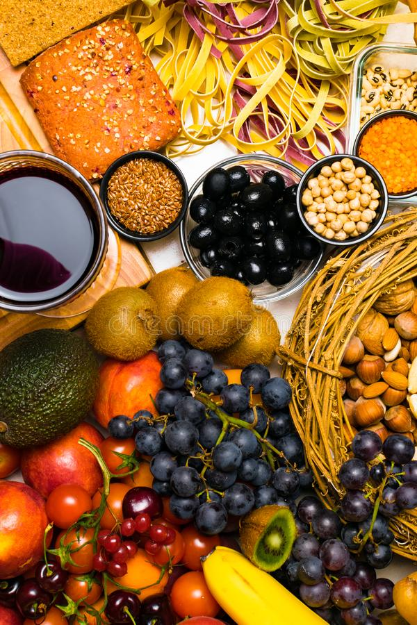 Mediterranean Food background. Assortment of fresh fruits, vegetables, nuts, seeds, beans and wine. Top view. Mediterranean Food background. Assortment of fresh stock photos