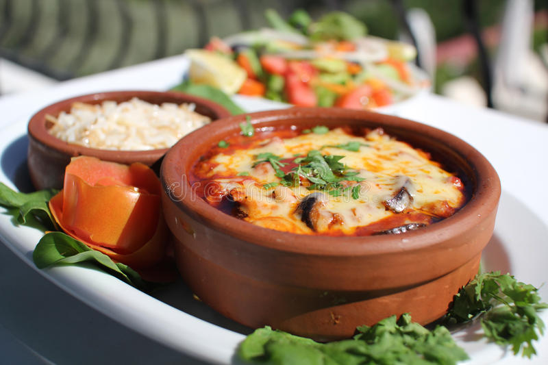 MEDITERRANEAN FOOD IN CYPRIOT CLAY POT stock images