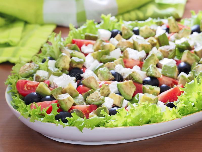 Greek Salad with olives, avocado and feta. royalty free stock images