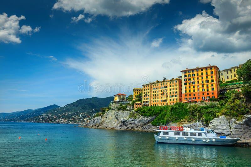 Mediterranean harbor with touristic boat, Camogli resort, Liguria, Italy, Europe stock photography