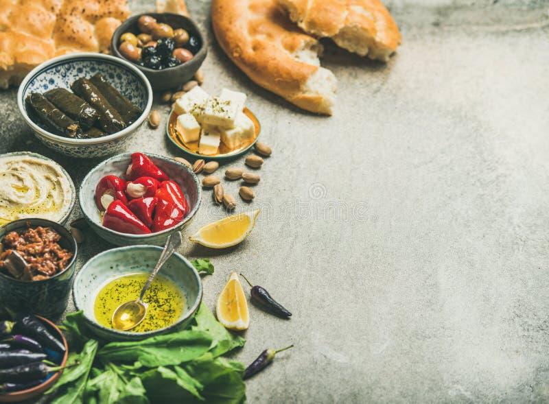 Mediterranean or Middle Eastern meze starter fingerfood assortment. Mediterranean, Middle Eastern meze starter platter. Stuffed pickled paprikas, dolma, hummus stock image