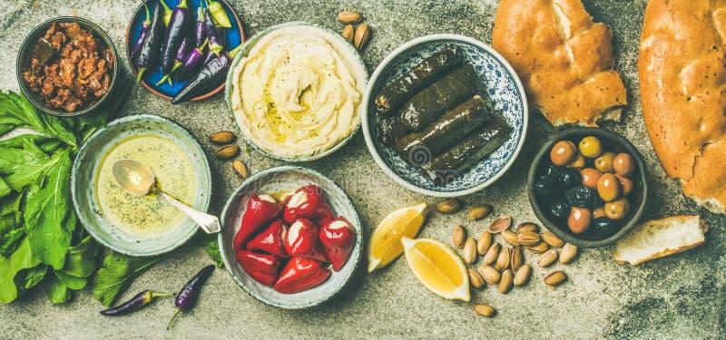 Mediterranean or Middle Eastern meze starter fingerfood platter. Mediterranean, Middle Eastern meze starter platter. Stuffed pickled paprikas, dolma, hummus royalty free stock photo