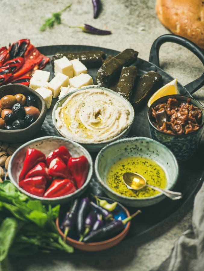 Mediterranean or Middle Eastern meze starter fingerfood platter in tray. Mediterranean, Middle Eastern meze starter platter. Stuffed pickled paprikas, dolma stock photos