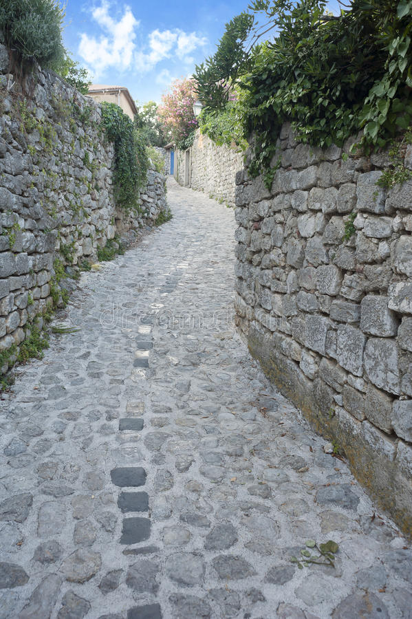 Mediterranean Narrow stone paved street royalty free stock photo
