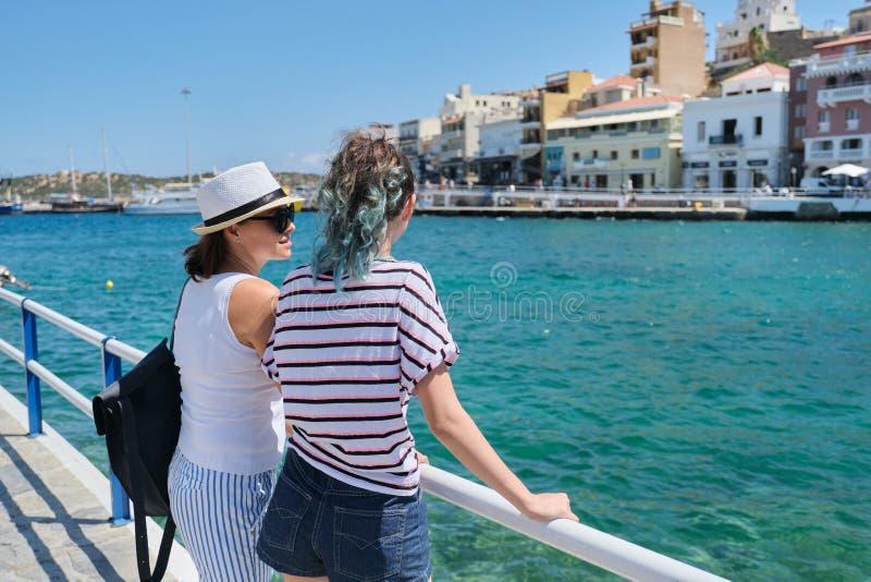 Mediterranean, people women backs near sea promenade royalty free stock photos