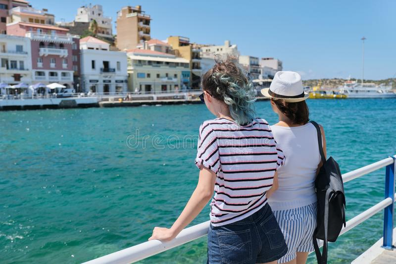 Mediterranean, people women backs near sea promenade royalty free stock photography