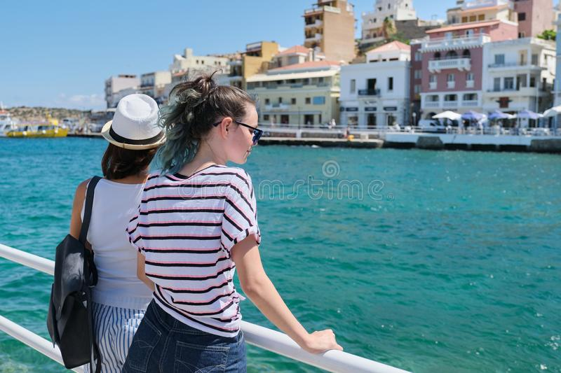 Mediterranean, people women backs near sea promenade royalty free stock photo