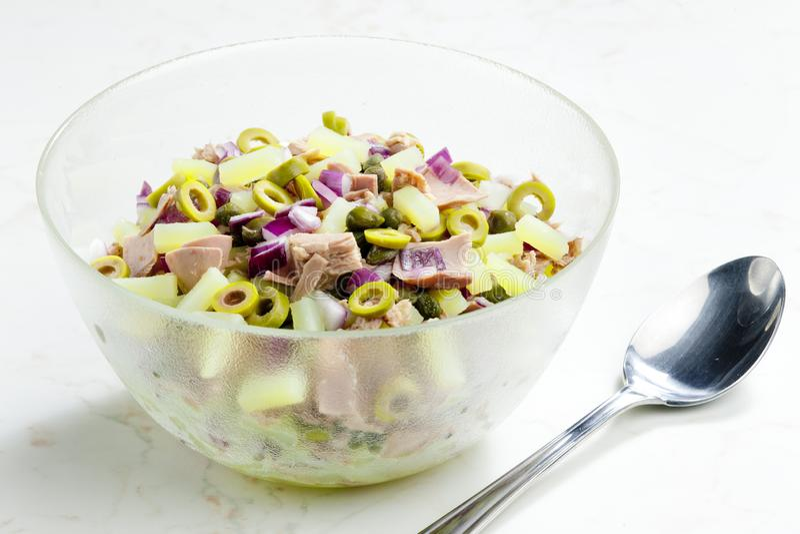 Mediterranean potato salad with tuna fish stock photography