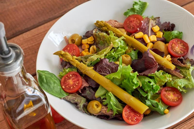Mediterranean salad with asparagus and tomatoes stock photo