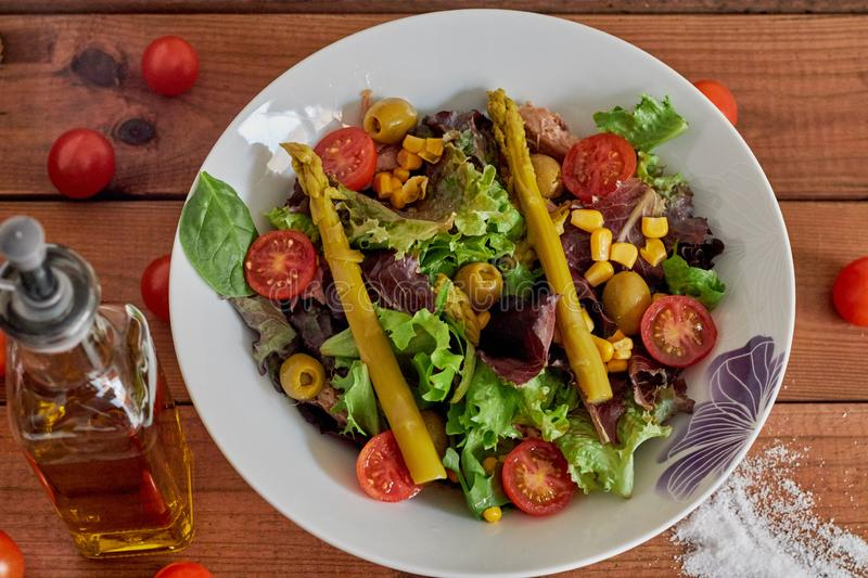 Mediterranean salad with asparagus and tomatoes stock images