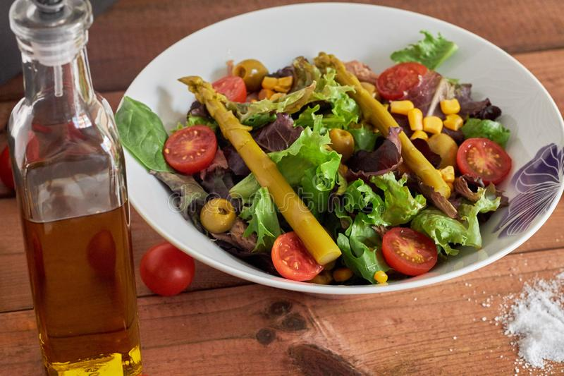 Mediterranean salad with asparagus and tomatoes royalty free stock image