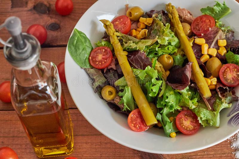 Mediterranean salad with asparagus and tomatoes royalty free stock photography