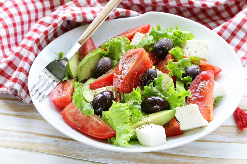 Mediterranean salad with black olives, lettuce, cheese stock photos