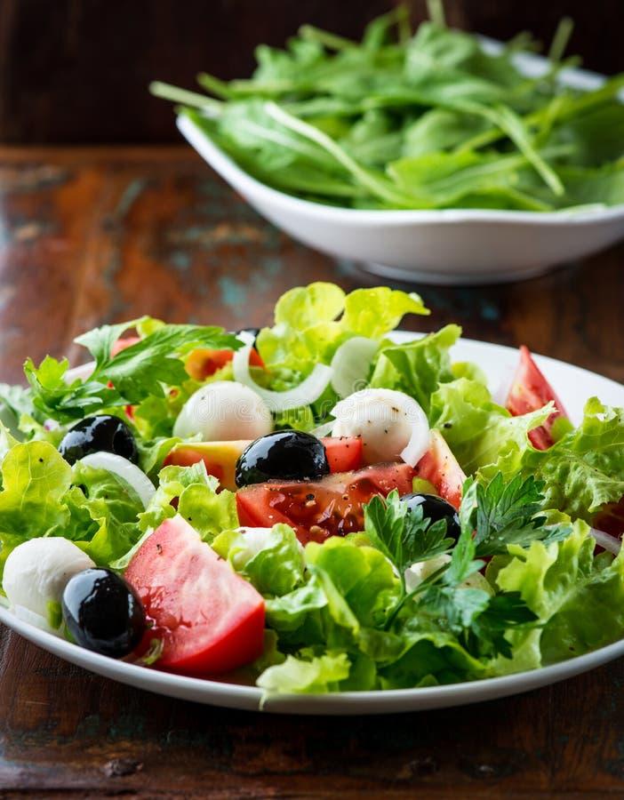 Mediterranean salad with mozzarella and olives stock photo