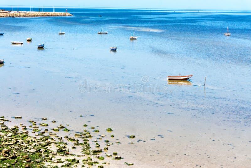 Mediterranean Sea with Boats in Houmt El Souk in Djerba, Tunisia. Boats in the Mediterranean sea in Houmt El Souk in Djerba, Tunisia stock photo