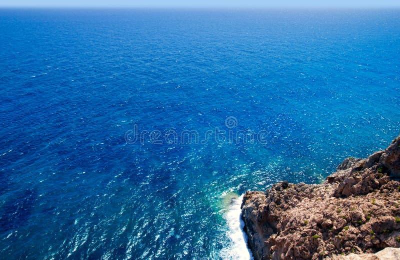 Mediterranean sea foam rocky shore. In formentera Barbaria cape stock photography