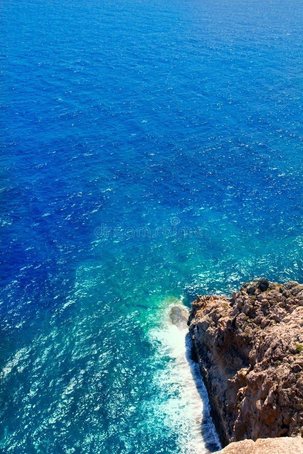 Mediterranean sea foam rocky shore. In formentera Barbaria cape stock photo