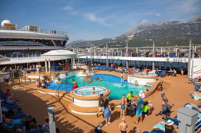 Mediterranean sea, Montenegro - 15.10.2018: Tourists relax at swimming pool at Cruise liner Norwegian Star during a royalty free stock images