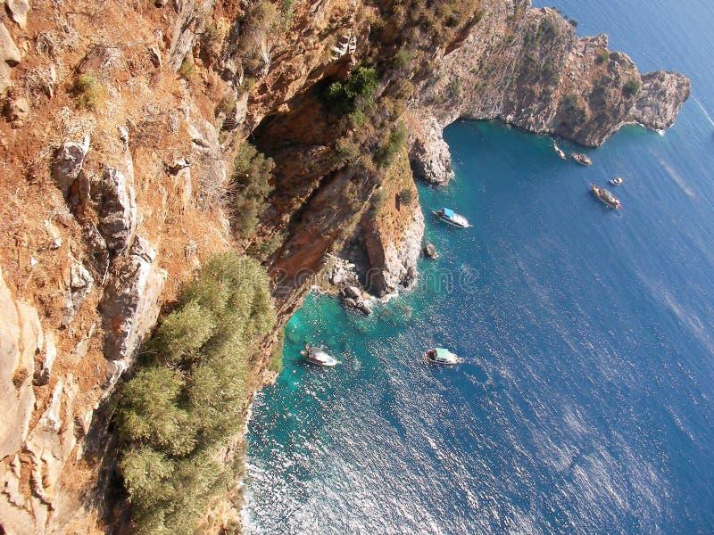 Mediterranean sea, mountains and rock at Alanya (country Turkey) royalty free stock image