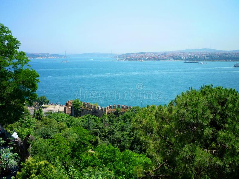 In the Mediterranean Sea port. A wonderful view of the Mediterranean port. the blue sea with its waves. fully vegetate the image plane stock images