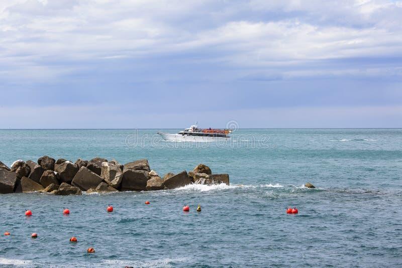 Mediterranean sea, tourist ship near the port, Riomaggiore, Cinque Terre, Italy.  royalty free stock image