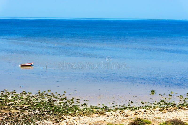 Mediterranean Sea View in Houmt El Souk in Djerba, Tunisia. Boat in the Mediterranean sea in Houmt El Souk in Djerba, Tunisia royalty free stock photos