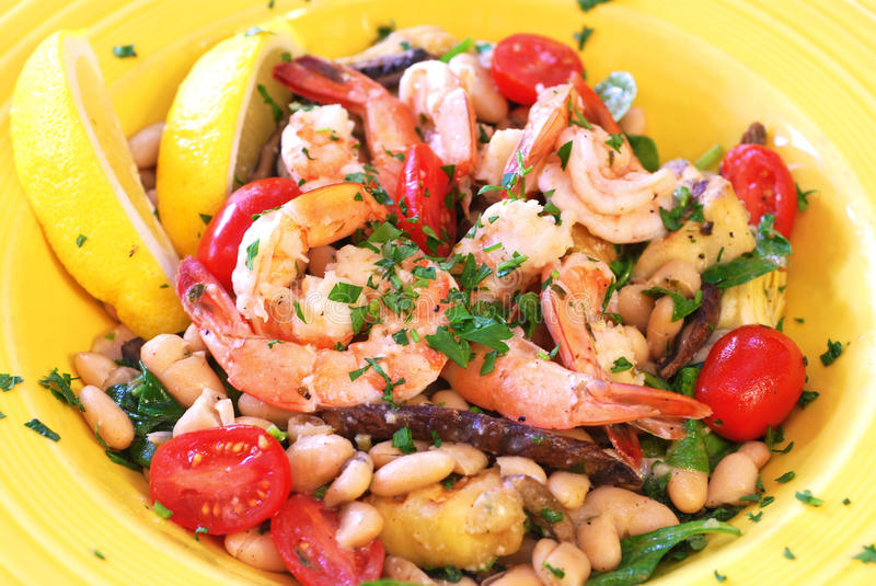 Mediterranean Seafood Saute. Mediterranean shrimp with sauteed vegetables and white beans stock photography