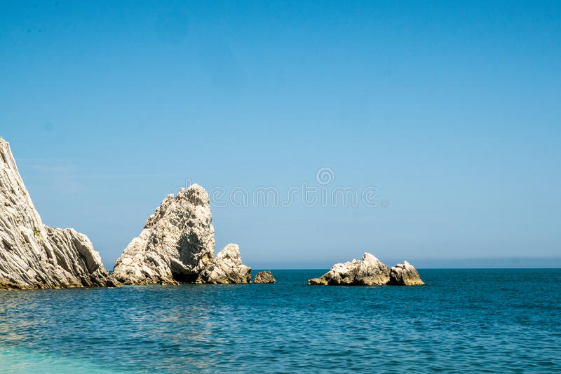 Mediterranean seascape of Le Due Sorelle, famous beach of Conero, Marche Italy royalty free stock photography