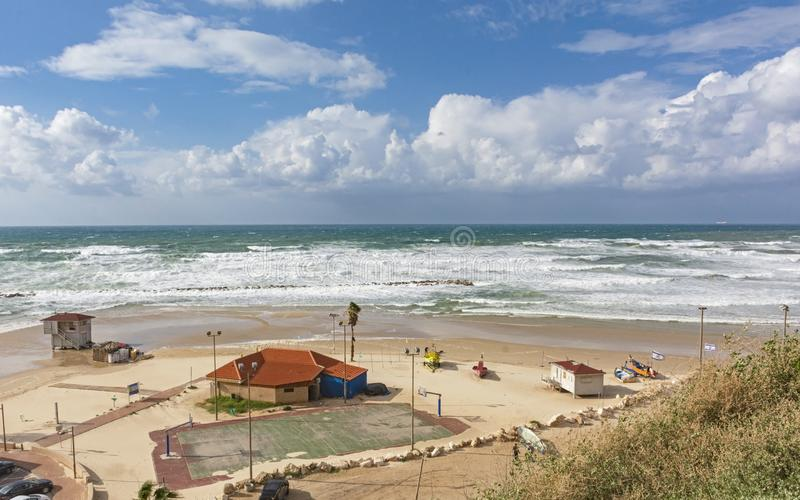 Sports Beach on the Mediterranean at Netanya in Israel. Mediterranean sports beach at Netanya in Israel showing surf, small boats and a basketball court under a royalty free stock photo