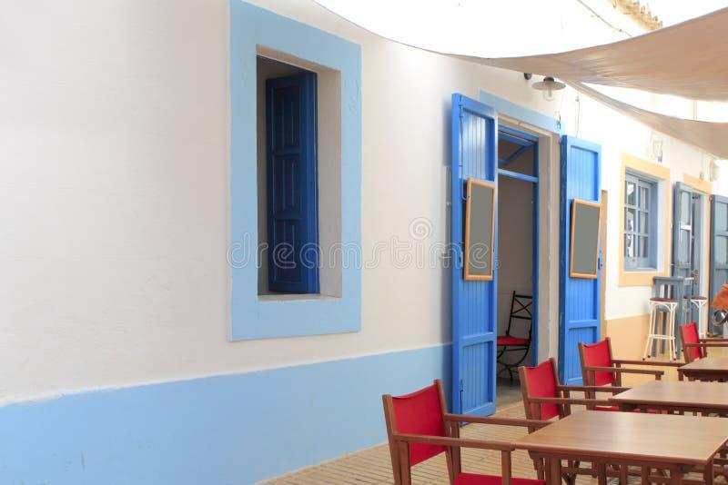Mediterranean street white houses bar Formentera stock photos