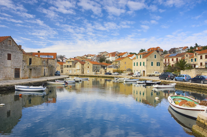 Mediterranean town parted with channel. (Croatia, Hvar royalty free stock photos