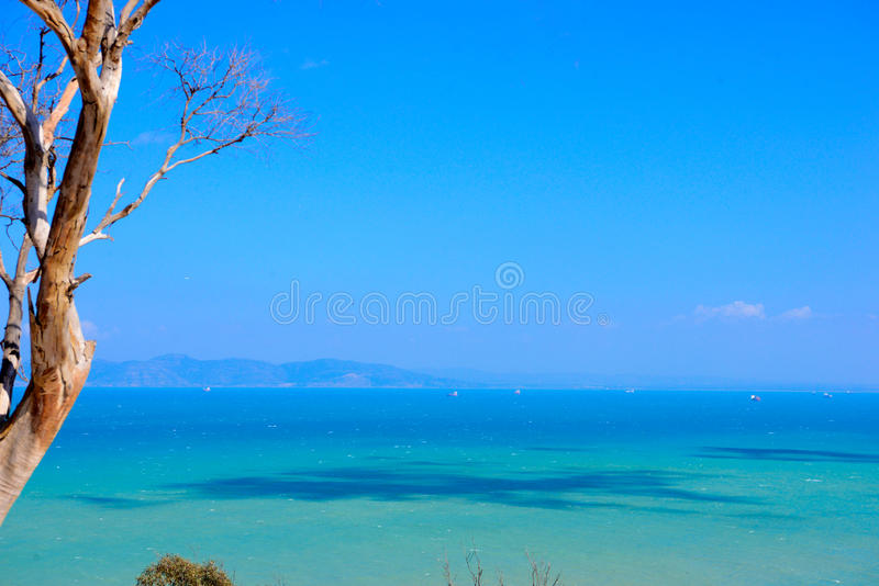 Sidi Bou Said, Tunisian Mediterranean Sea, Turquoise Blue Water. Mediterranean turquoise blue sea scenery with clouds shadows. View from one of the streets of royalty free stock photo