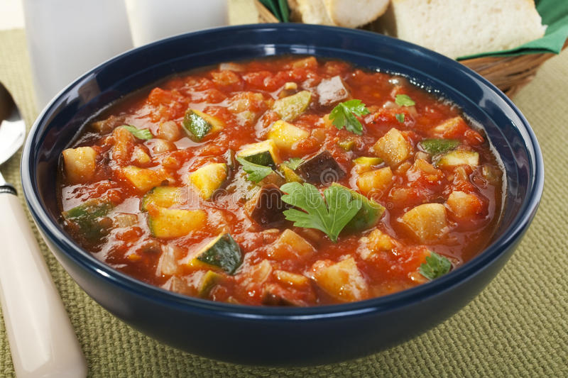 Mediterranean Vegetable Soup Ratatouille. A juicy soup, made from tomatoes, courgettes, capsicums, aubergines, onions and garlic. It's basically ratatouille royalty free stock images