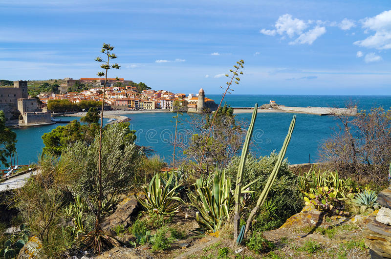 Mediterranean vegetation with sea and a village royalty free stock images