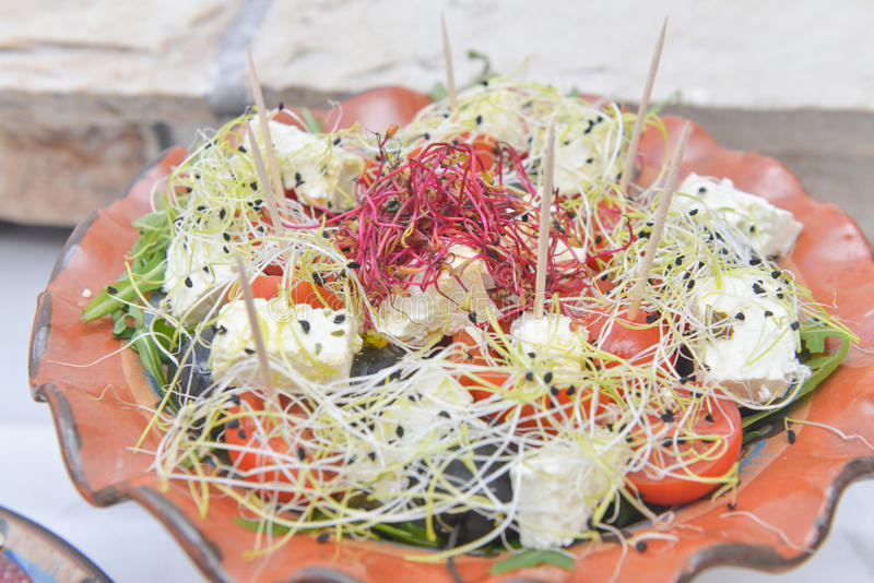 Meditteranean style salad with cheese royalty free stock photo
