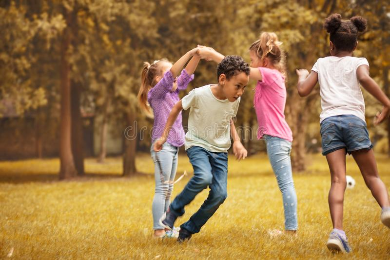 Medium group of children playing at public park. stock images